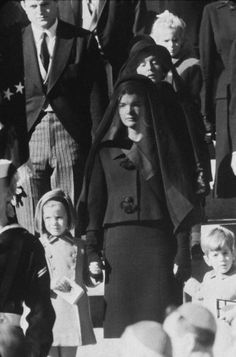"""The caption that accompanied another, cropped version of this photograph when it appeared in the December 6, 1963, issue of LIFE: """"Wife. Mother. Niece. Three generations wait outside St. Matthew's for procession to cemetery. Behind Mrs. Kennedy stands the President's mother. Sydney Lawford, daughter of Kennedy's sister Pat, is at rear."""""""