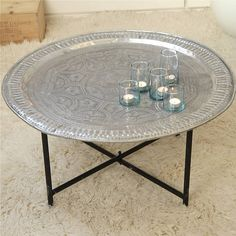 Amazing vintage Moroccan tray, the perfect occasional table.All trays have different design, but most patterns are either on the geometrical theme or flowers. Please note that legs as seen on the picture are not included.In the true oriental fashion, welcome your guest with drinks and nibbles on a unique antique table. These trays are all individual pieces and come from all over the country. As they are light they are easy to carry from one room to the other as well as outdoor for a cosy ...