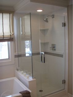 Standing shower with bright white tiles.