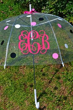 Personalized Clear Bubble Umbrella with monogram & polka dots with a white curved handle by Bedtime Vinyl Creations.