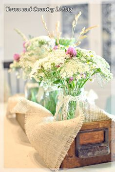 fresh flowers inside Ball jars in old drawer on table