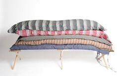 Beautiful bed rolls to send me off the sleep in pure glamping luxury. Hedgehouse Striped Throw Beds | Remodelista