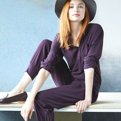 Don't worry, jumpsuits aren't going anywhere. For fall try on darker tones and top with a wide-brimmed felt hat.