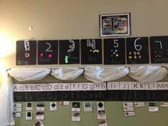 A Reggio Inspired Classroom -Number line, numbers made with pins and yarn, counters made using natural objects (e.g.,acorns, rocks)