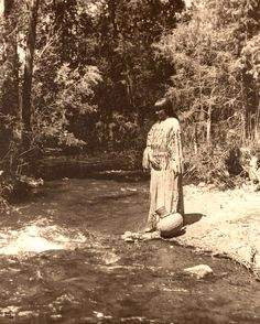 Taos Pueblo woman by a stream. New Mexico. Early 1900s. Photo by Carl Moon. Source - Huntington Digital Library.