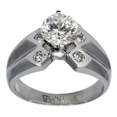 Contemporary Wide Diamond Accented Engagement Ring -  This contemporary engagement ring can accommodate any size or shape center diamond.    This wide white gold diamond ring is enhanced by brilliant round bezel set diamonds. The white gold shank also has a fluted design. This ring has an excellent design, sleek lines and simple elegance.    At Dacarli emphasis is placed on design, quality, and modern, high-tech manufacturing techniques. The settings for our rings are made in our Florida...