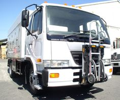 UD Nissan 2300LP cab over ice cream truck with ColdCar USA cold plate freezer body and HTS-10T installed by General Truck Body of Los Angeles, California. Commercial hand trucks can take-up 12'-15' cubic feet of valuable cargo space! HTS Systems' commercial delivery equipment is a safe fleet solution.