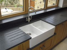 #NeroImpala honed #granite ontop of double belfast sink and double #drainergrooves, granite undersill and granite windowsill