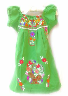 Green Mexican dress lovely hand embroidery work off shoulder sleeves. $58,00, via Etsy.