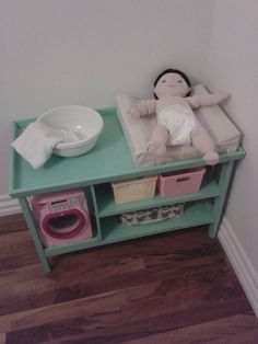 baby doll changing table found small stand with wheels at the thrift store painted added trim. Black Bedroom Furniture Sets. Home Design Ideas