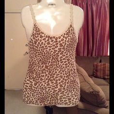 """Lucky Brand Tank Lucky Brand Tank is made of 100% Cotton. Size Small. Colors are: Off white/brown/tan.  Animal Print. Top stretches. Length """"25. Laying flat """"12. This item is NOT new, It is used and in Good condition. Authentic and from a Smoke And Pet free home. All Offers through the offer button ONLY.  Ask any questions BEFORE purchase. Please use the Offer button, I WILL NOT negotiate in the comment section. Thank You Lucky Brand Tops Tank Tops"""