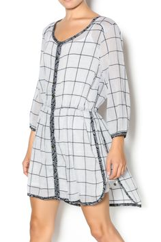 Black and grey shirt dress with floral hem detailing. Buttoned front and elastic waist. Semi-sheer. Wide grid pattern. Grid Shirt Dress by Aretta Silent Journey. Clothing - Dresses - Printed Clothing - Dresses - Casual Indiana