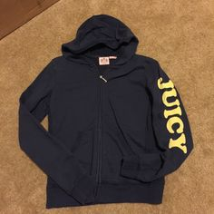"""Navy Juicy Couture Track Jacket with Hood; Large Navy Juicy Couture Hooded Track Jacket with light yellow writing; size Large. Has 2 front pockets. """"JUICY"""" is written on the side of the left sleeve. The back has a big smiley face with """"BE JUICY"""" underneath it. Zipper pull is the letter 'J' (see 3rd pic). Material: 100% Cotton. Reasonable offers welcome. No trades Juicy Couture Jackets & Coats"""