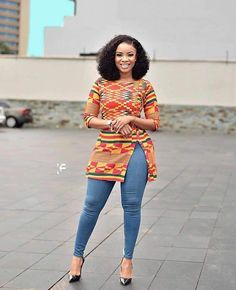 How To Select Little One Dresses Kente Printed Tunic Skinny Jeans Black Pumps African Fashion Ankara, Latest African Fashion Dresses, African Dresses For Women, African Print Fashion, African Attire, African Print Dresses, African Tops For Women, African Blouses, Style Africain
