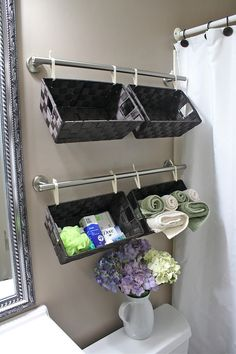 Organizing with Baskets • A roundup of great Ideas and Tutorials! Including, from 'simply diy 2', this fantastic bathroom wall full of baskets project.