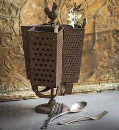 How neat is this utensil holder? Made from rusted cheese graters, it's sure to get the conversation going! Metal Grater Utensil Holder x x Antique Farmhouse, Farmhouse Style, Farmhouse Decor, Farmhouse Rules, Farmhouse Ideas, Kitchen Utensil Holder, Kitchen Utensils, Utensil Organizer, Cutlery Storage