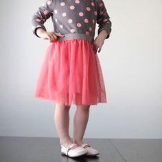 Add a sweet gathered tulle skirt to a store-bought tee for a ballet-style dress for a little girl. Easy sewing tutorial includes step-by-step photos.