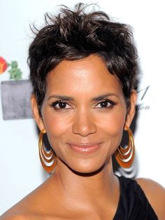 Halle Berry                                                                                                     After a stint wearing her hair in her long natural curls, Halle is back to her signature pixie cut at the 2011 FiFi Awards. This hairstyle really allows her best features to shine.