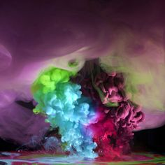 """Photographer Mark Mawson drops different hues and densities of paint to water to create complex kaleidoscopes of colour he describes as """"alien"""".     Mark has been nominated for the 2012 London Awards for Performance and Art in the photography section."""