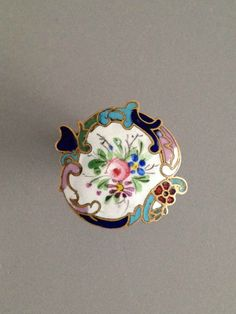 French enamel button with rococo border