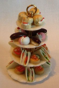 Plate stand with four layers of high tea food by Abasketof on Etsy, £18.00