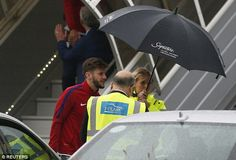 Liverpool winger Adam Lallana is escorted to a taxi under an umbrella as England players arrive home England Euro 2016, England Players, Taxi, Liverpool, Inspiration, Biblical Inspiration, Inspirational, Inhalation
