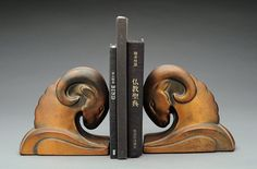 Art Deco Ram Bookends.  Nice flow and balance- base suggests lateral movement (outwards, countering the inward movement of the butting heads)