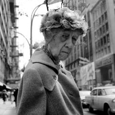 VIVIAN MAIER  Untitled (woman with floral hat), 1961