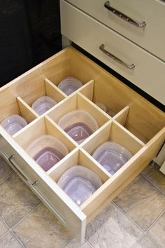 The solution to that junkie Tupperware cabinet. Good for OCD'ers (and me).