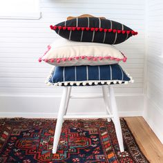 poms stacked on chair_sq.jpg