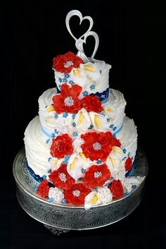Red, white, and blue cake for a 4th of July wedding. Ribbed buttercream and handmade fondant flowers.
