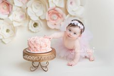 whimsical cake smash photo shoot with DIY paper flower backdrop by Nicole Starr Photography, Saratoga Springs Albany Boston baby photographer