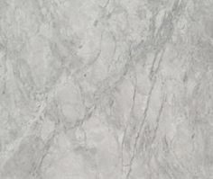 White Fantasy Granite: QUESTION: I'm aware that White Carrara Marble is frowned upon for kitchen counter use. If you really like the look of the White Carrara Marble but you're