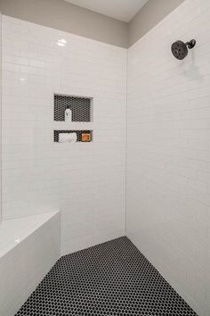 Black penny tile and white subway tile. Plumbing fixture is Delta Trinsic in Black. Tile Shower Niche, White Subway Tile Shower, Subway Tile Showers, Tub Shower Combo, Bathroom Showers, Bathroom Kids, Downstairs Bathroom, Laundry In Bathroom, Kids Bath