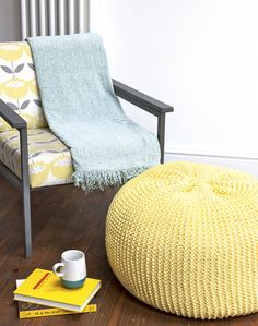 Team spring yellows with cool duck-egg blues for a fresh look. This mid-century inspired chair looks great paired with punchy yellow accents