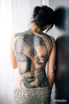 Buddha face on a woman's back