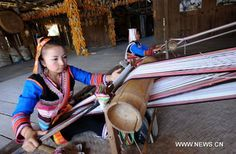 Villagers perform cloth weaving in a village of Jinuo ethnic group in Jinghong City of Xishuangbanna Dai Autonomous Prefecture, southwest China's Yunnan