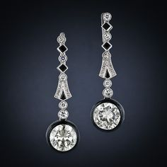 Diamond (6.70 total kts) and onyx earrings, 1925