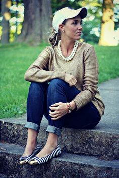 classic style: putting on a small fashionable or statement necklace with a sweater then fold the bottom of the jeans for a cute yet comfortable look.