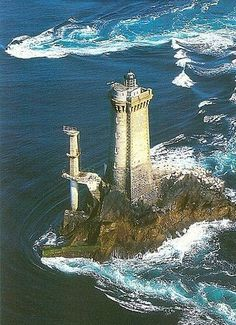 The Pointe du Raz is a promontory that extends into the Atlantic from western Brittany, in France. Brittany (in French Bretagne) is a region in the north-west of France. Magic Places, Lighthouse Pictures, Am Meer, Places To See, Beautiful Places, Scenery, Castle, Around The Worlds, Water