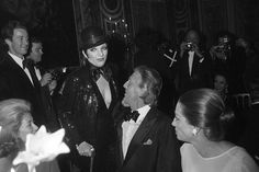 "Liza chats with Princess Grace and Givenchy at ""The Battle of Versailles"" wearing Halston in 1973"