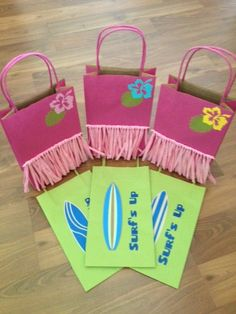 "Copy these *** Cute goodie bags! Girls are pink with ""skirts"" Boys are pale green with surfboards."