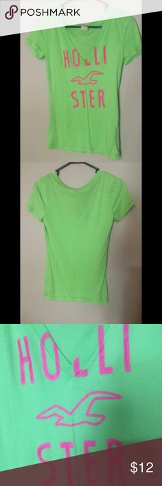 Pink and lime green shirt This shirt is neon pink and lime green with a v-neck neckline. Hollister is on the front of the shirt. Hollister Tops Tees - Short Sleeve