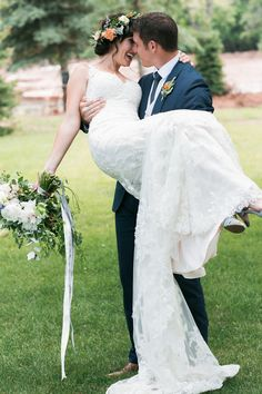lyons farmette; lucky malone photography; outdoor wedding; outdoor ceremony; outdoor reception; tented reception; farm wedding; groom holds up bride; bride in long lace gown