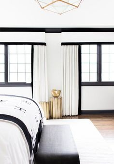 white walls. black molding. hermes blanket. is there anything more you need?