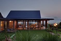 Wing House - tropical - exterior - hawaii - McClellan Architects // I love the complete openness of the living quarters of the house. You'd need a reasonably private lot to pull this off though.