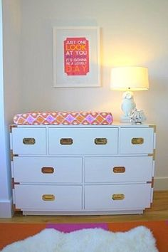 Another beautiful campaign dresser in classic white. This time, the dresser doubles as a changing table in this sweet orange and pink nursery.
