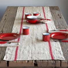 "PROVENCE LINEN TABLE RUNNER -- Hand loomed of natural fiber with classic country stripes, our linen table runner is equally well-suited to pasta in a penthouse or a picnic in the park. Pre-washed for softness and shrinkage. Machine wash. Imported. Exclusive. 90""L x 20""W."