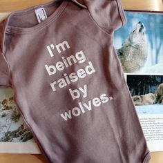"""Baby onesie: """"I'm being raised by wolves."""" Would it be even funnier if the font was more scrawl-like or the onesie was ragged? Cute Kids, Cute Babies, Baby Kids, Funny Kids, Raised By Wolves, Everything Baby, Baby Fever, Future Baby, Onesies"""