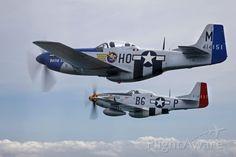 FlightAware ✈ Photo of 2 North American P-51 Mustangs